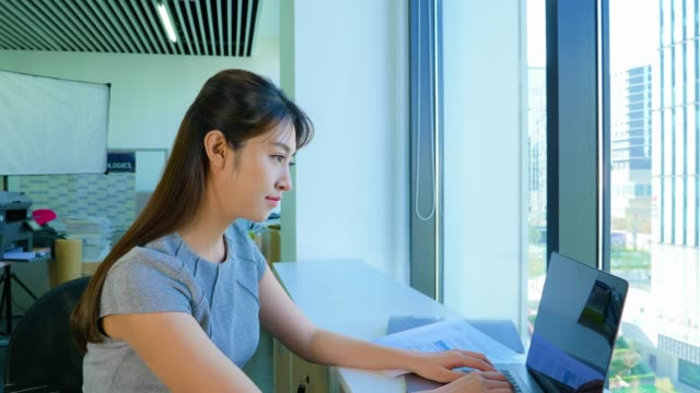 ms zi businesswoman working with laptop in office, beijing, china - beijing stock videos & royalty-free footage