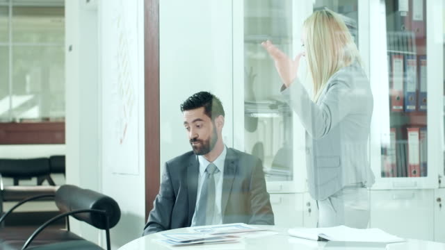 Businesswoman yelling at colleague