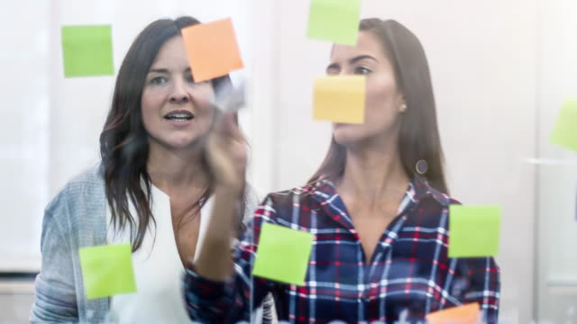 businesswomen brainstorming for new ideas at office - colombian ethnicity stock videos & royalty-free footage