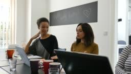 Businesswomen discussing in meeting over start up