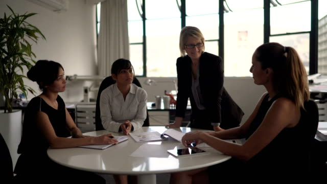 businesswomen discussing on project at table - round table discussion stock videos & royalty-free footage