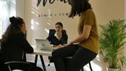 Businesswomen discussing over start up at desk