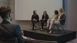 Businesswomen during seminar in auditorium