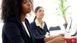 Businesswomen listening in new business meeting