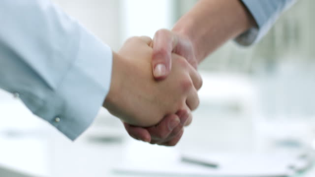 businesswomen shaking hands - handshake stock videos and b-roll footage