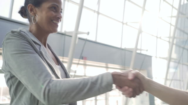 businesswomen shaking hands - congratulating stock videos and b-roll footage