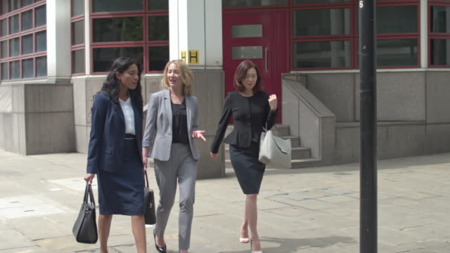 Businesswomen talking while commuting in London