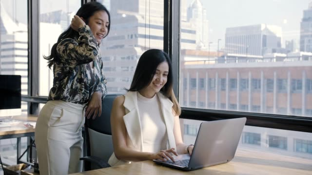 businesswomen using laptop in office - females stock videos & royalty-free footage