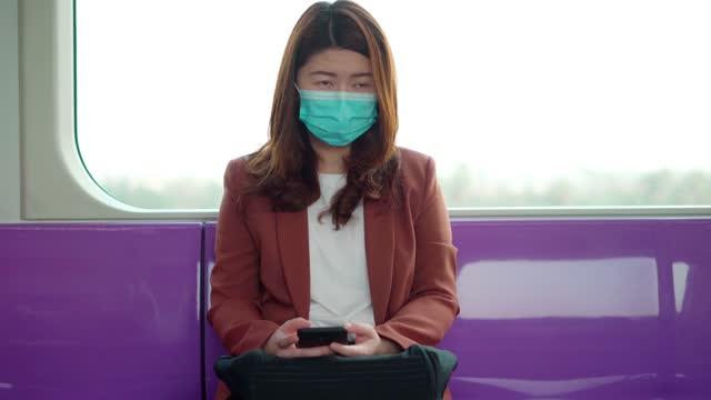 ฺbusinesswomen wearing face mask for protection at subway station platform - eternity stock videos & royalty-free footage