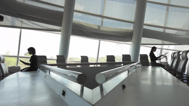 businesswomen working in spacious conference room - conference table stock videos & royalty-free footage