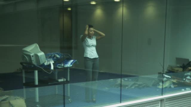 Businesswomman getting stressed in office; UK