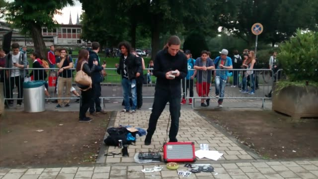 busker performing outside of 'gamescom 2014' in cologne, germany shows off a unique 8 bit music performance using only 2 game boys and a speaker! bet... - only boys stock videos & royalty-free footage