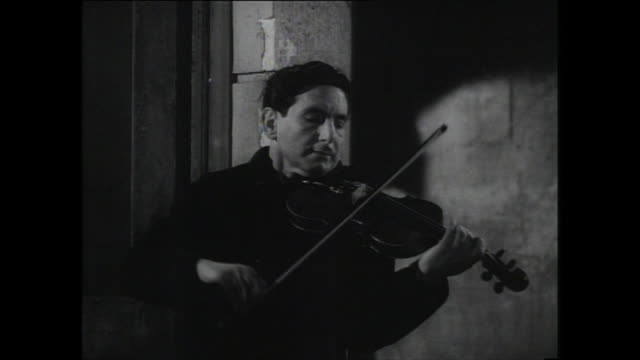 busker plays violin at night; 1959 - 1959 stock videos & royalty-free footage
