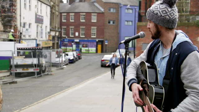 busker singing in the street - guitar stock videos & royalty-free footage