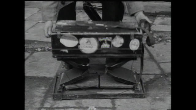 busker unfolds portable harmonium; 1959 - 1959 stock videos & royalty-free footage