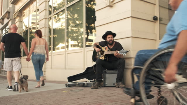 busking street musician - street performer stock videos and b-roll footage