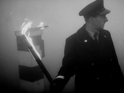 busmen use burning torches to guide traffic through thick fog - 1952 stock videos and b-roll footage