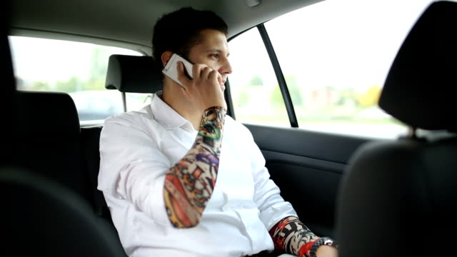 bussines mam with tattoos in car - sleeve stock videos and b-roll footage