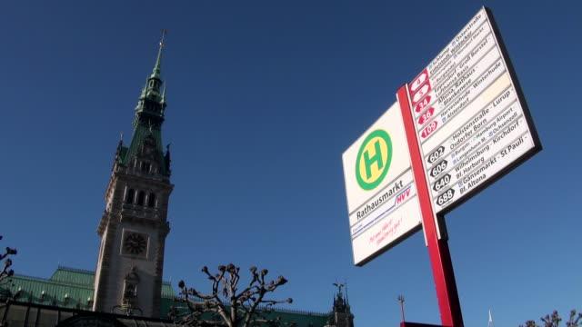 ms busstop board at city hall/ hamburg, hamburg, germany - bus stop stock videos & royalty-free footage