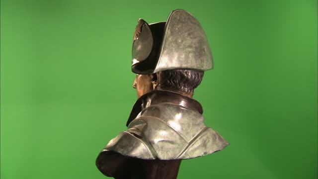 A bust of Napoleon Bonaparte spins against a green screen.