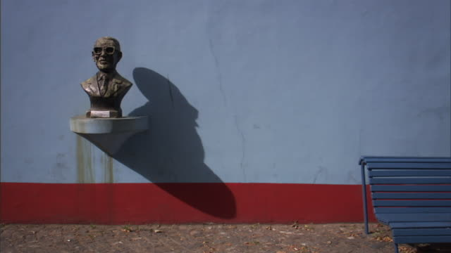 MS Bust of tango master Juan de Dios Filiberto on shelf next to park bench in La Boca neighborhood/ Buenos Aires, Argentina