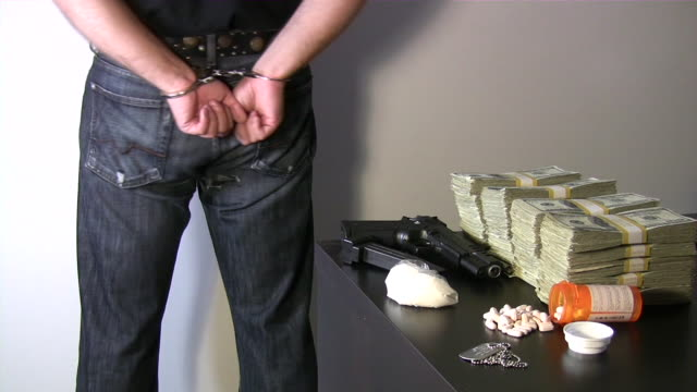 Busted with gun, cash money, narcotics.