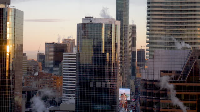 bustling downtown city in the morning light - fatcamera stock videos and b-roll footage