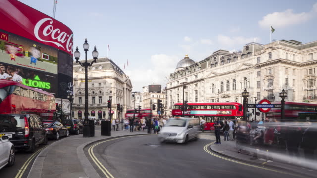 A bustling Picadilly Circus in central London, UK.