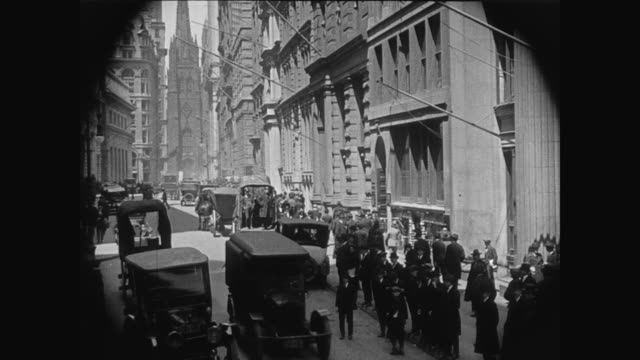 1920 bustling wall street in nyc - 1920 stock-videos und b-roll-filmmaterial