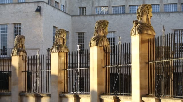busts outside the clarendon building on broad street, oxford, which was built to house the oxford university press. - stone object stock videos & royalty-free footage