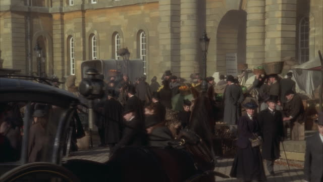 vidéos et rushes de ms, pan, reenactment busy 19th century food market - reconstitution