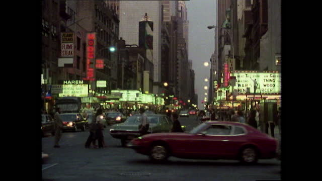 ws busy 42nd street and marquee signs in new york at dusk; 1980 - new york city stock videos & royalty-free footage