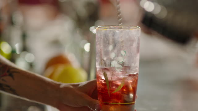 busy bartender stirs colorful mixed drink - mixing stock videos & royalty-free footage
