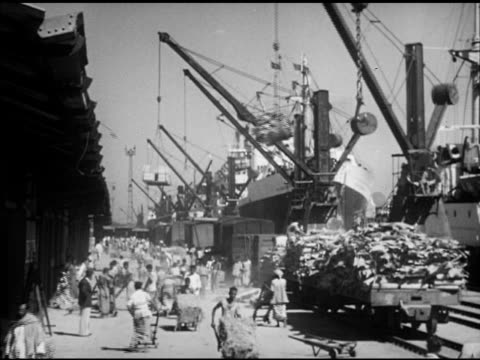 busy bay of bengal docks, ships being loaded by cranes, boxes, workers on deck, directing single bale of unidentified crop toward cargo hold.... - bangladesh stock videos & royalty-free footage