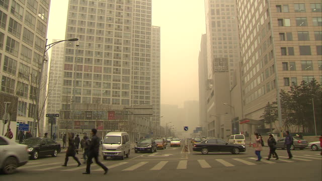 busy beijing, china intersection. - smog stock videos & royalty-free footage