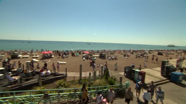 busy brighton beach on a sunny bank holiday monday, as crowds enjoy the seaside as coronavirus lockdown restrictions ease - sunlight stock videos & royalty-free footage