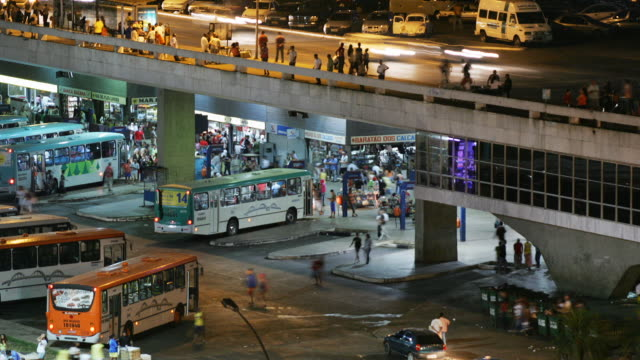 stockvideo's en b-roll-footage met t/l, ws, ha, busy bus station at night, brasilia, brazil - commercieel landvoertuig