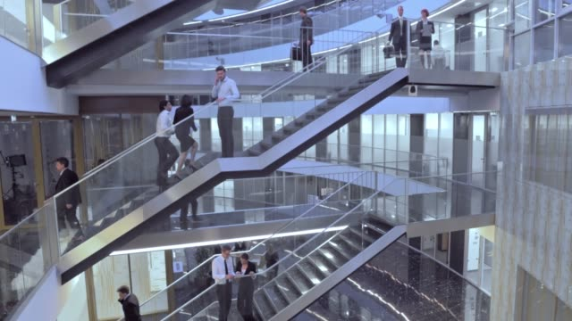 aerial busy business building hallways - staircase stock videos and b-roll footage