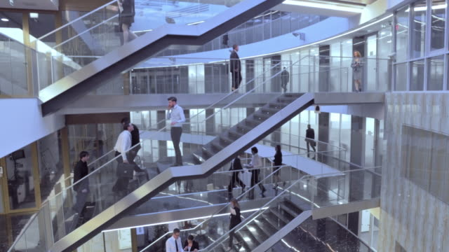 aerial busy business building staircases - corporate business stock videos & royalty-free footage