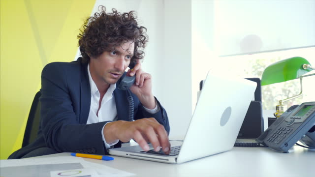 busy businessman working in his office. - concentration stock videos & royalty-free footage