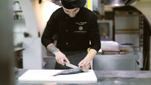 busy chef in fish restaurant - kitchen worktop stock videos and b-roll footage