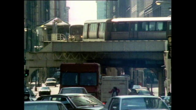 busy chicago street with elevated train passing over; 1985 - chicago 'l' stock videos & royalty-free footage