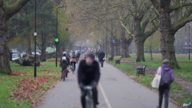 a busy city cycle lane in winter as the early morning commuters go to work - hackney stock videos & royalty-free footage
