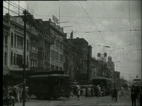 b/w busy city street with people and trolleys / new orleans / 1915 / no sound - 1910 stock videos & royalty-free footage