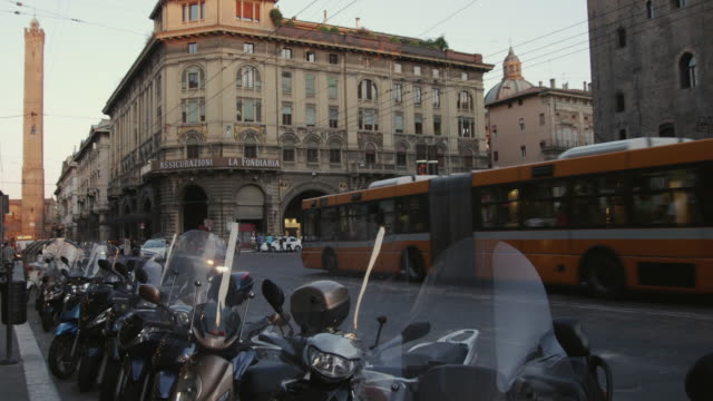 WS Busy city street with row of motorcycles in foreground / Bologna, Italy
