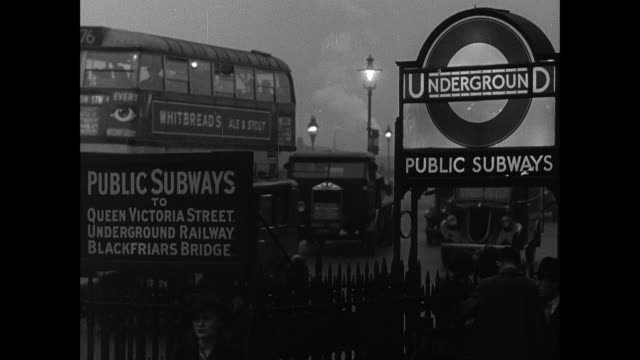 montage busy city streets filled with pedestrians, cars, trucks and buses commuting after work / london, england, united kingdom - 1930 video stock e b–roll
