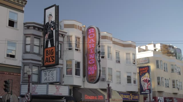 busy columbus avenue and clubs signs on buildings in north beach district at sunset, san francisco, california, united states of america, north america - north beach san francisco stock videos and b-roll footage