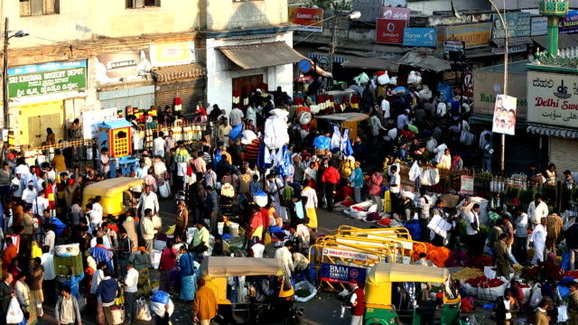 busy commercial outdoor city flower market, bangalore, india - bangalore stock videos and b-roll footage