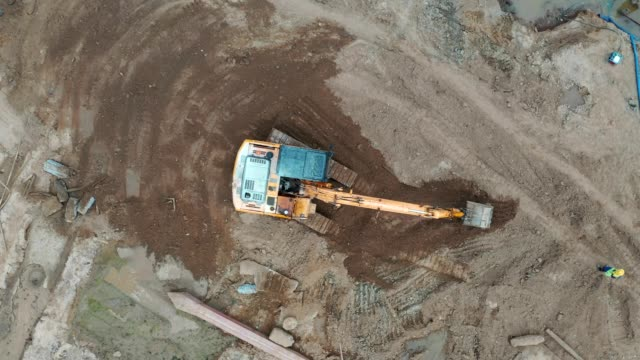 busy construction job site, aerial view, many men, worker working at civil site - concrete stock videos & royalty-free footage