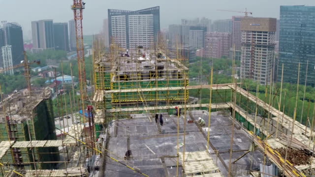 busy construction site and cranes in modern city,real time. - high up stock videos & royalty-free footage